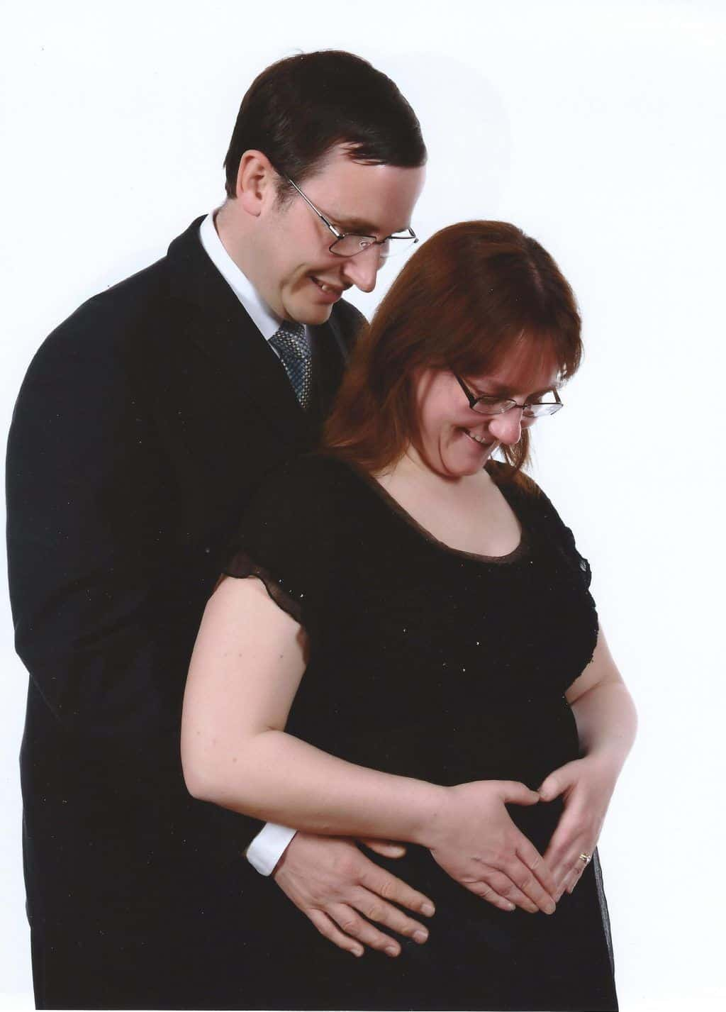 Pregnant lady with hands in heart shape on her tummy